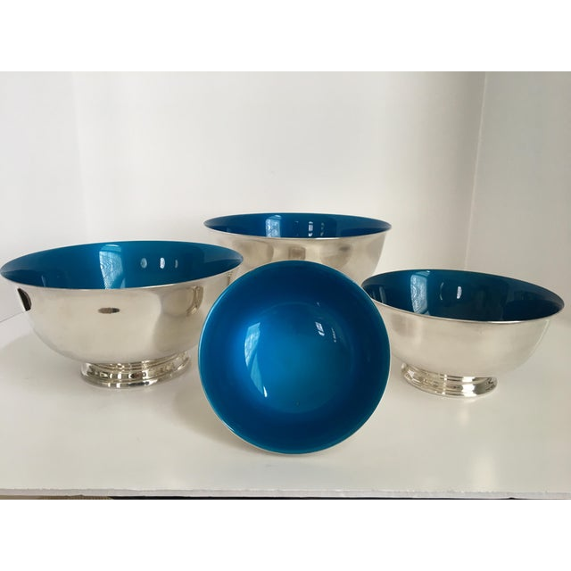 Offering a rare 1960's silver plated complete set of four graduated Reed & Barton Revere enameled, Peacock Blue, bowls....