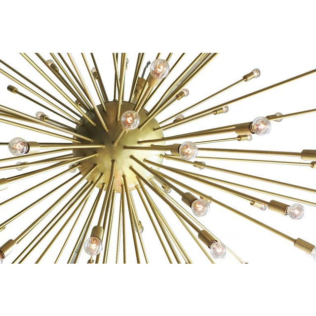 Large 5 foot Mid-Century Modern style Sputnik chandelier consisting of over a 100 brass rods that extend from its brass...