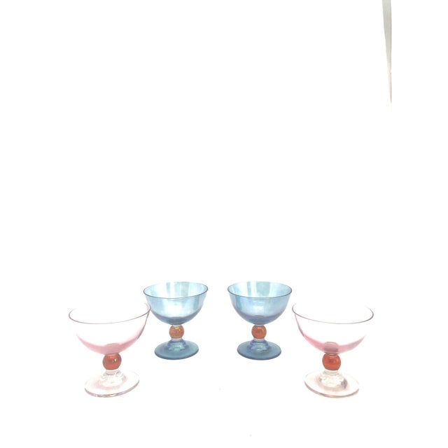 This set includes 2 pink and 2 blue Cerve glasses. Three of the 4 glasses still have the original Cerve sticker on them....