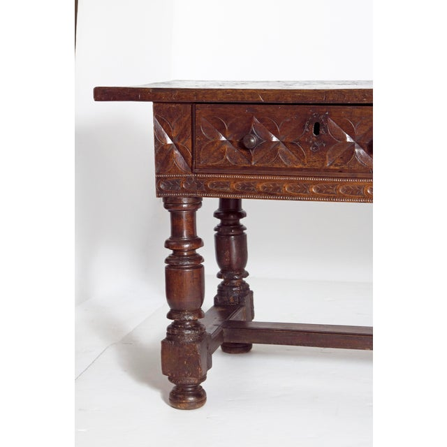 A large late 17th century Spanish hand carved walnut library or center table with beautiful color and patina. The top is a...