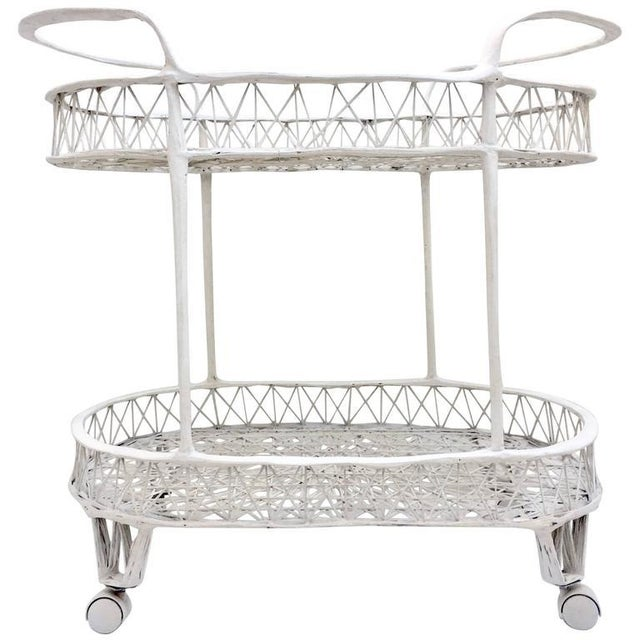 Mid-Century Modern spun fiberglass rolling bar cart by, Russell Woodard. Painted in white with original rolling castors....