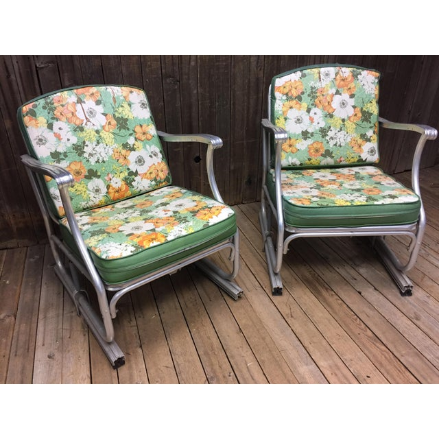 (2) VINTAGE METAL PORCH CHAIRS. Matching set with neat sliding glider design. Has streamlined Modernist lines. Chairs...
