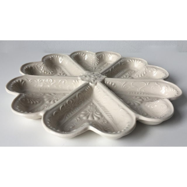 This charming salt-glazed serving or 'pickle' dish is in classic English style.6 heart-shaped compartments, great to use ,...