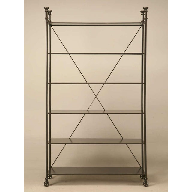 Industrial style steel and bronze etagere available in any size you chose. In lieu of steel for the frame work, we...