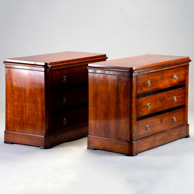 Pair of three-drawer English mahogany chests with nicely figured wood and black detailing at the edges, circa 1940s....