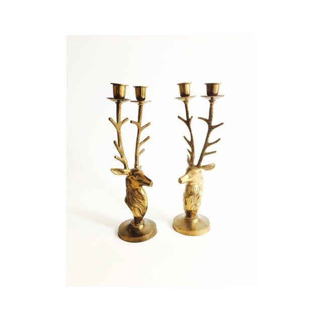 A set of 2 gorgeous candlestick holders formed in shiny gold brass. Each candle holder is in the shape of deer's bust with...