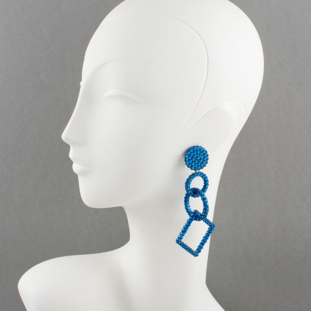 Statement chandelier clip-on earrings designed by Richard Kerr in the 1980s. They are made up of his signature pave...