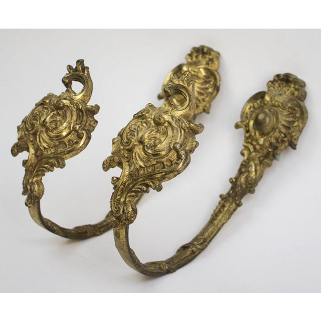 Fabulous pair of French Ormolu bronze drapery/curtain holdbacks. Heavy quality each weighing approx. 1 lb, with beautiful...
