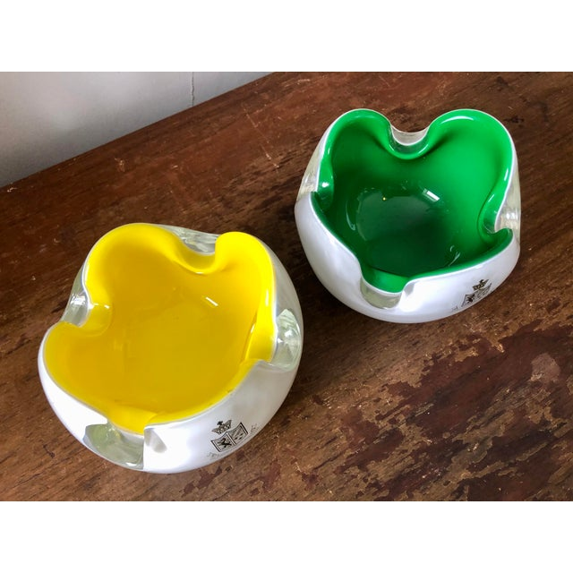 A pair of mid century cased Murano glass ashtrays from Hong Kong & Shanghai Hotels Ltd.