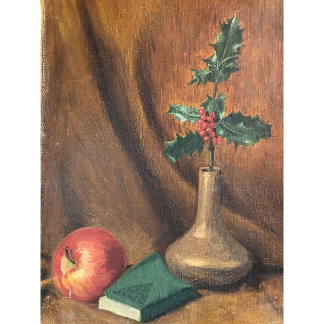 This is a lovely vintage still life on board with holly branch in situ with an apple and book. Perfect for holiday season.