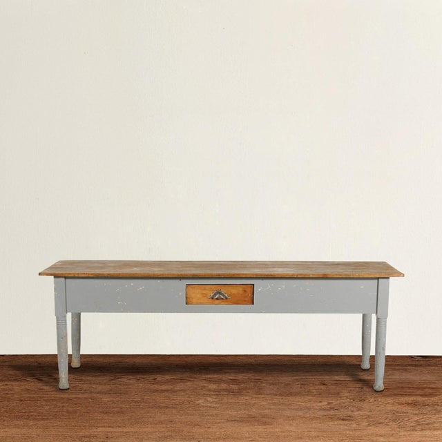 A wonderful early 20th century American maple farm table with an unfinished top, and gray painted sides and turned legs,...