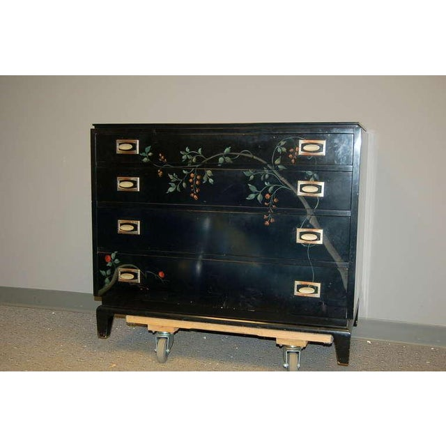 Stylish chest for Johnson Brothers by Renzo Ritili. Black lacquered base with floral painted detail. Stylized period brass...