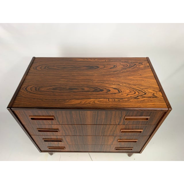 This Danish modern mid century gentleman's chest in Brazilian rosewood was manufactured by Børge Seindal for Westergaard...