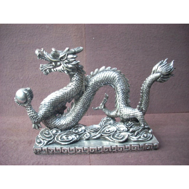 Traditional Chinese dragon holding the pearl of great price; light resin with silver finish with black wash to highlight...