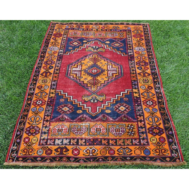 Vintage Distressed Turkish Tribal handmade Oushak rug in Red and Orange. Made with 100% organic wool. It has been...