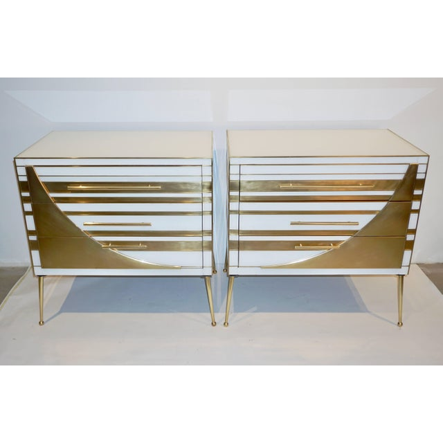 This Italian exclusive pair of modern chests, that can be used as end, side tables or nightstands, present a unique Art...