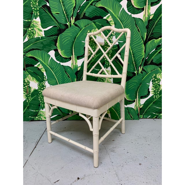 Set of 6 dining chairs in chinoiserie style with Chinese chippendale style fretwork. Chairs are upholstered in a neutral...