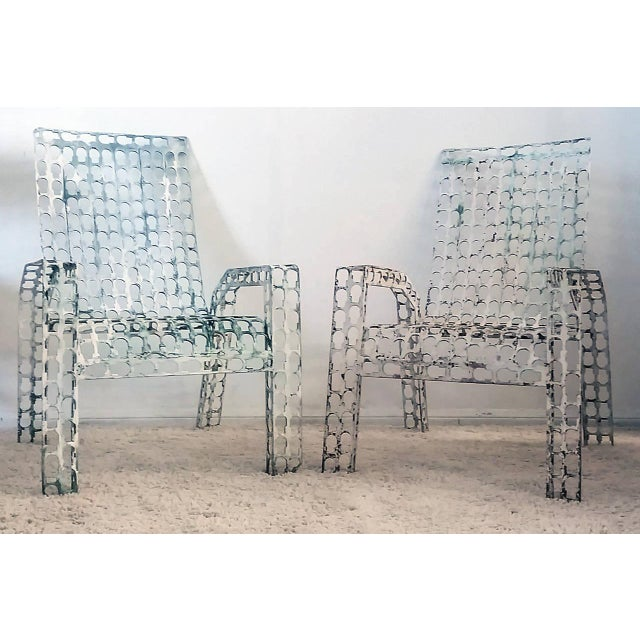 A very unique pair of vintage chairs that are made of welded steel. The chairs have been painted, and appear to have been...