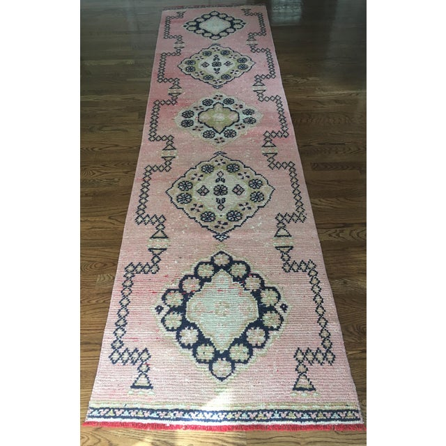 Stunning and elegant handwoven Anatolian tribal runner with a faded pink background and accents of navy, ivory and...