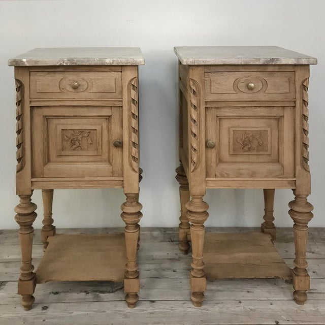Pair Antique French Louis XVI Stripped Marble Top Nightstands feature tailored neoclassical lines, cabinet and drawer...