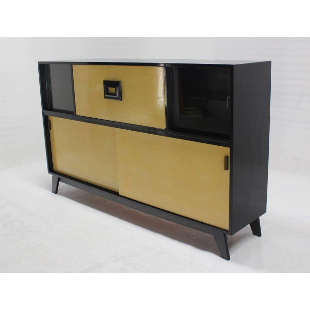 Mid-Century Modern bar liquor cabinet credenza. Two-tone black lacquer and bleached oak finish.