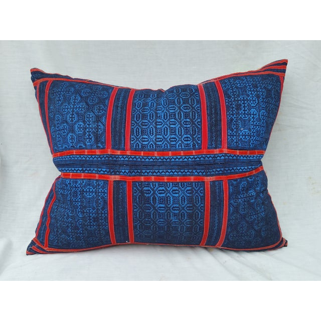 A hand batiked/ appliquéd tribal pillow with natural indigo dye design. Made from 1940's Yao hill tribe skirt fragment....