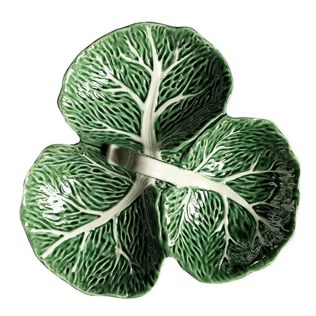Green cabbage ware serving epergne. Item depicts three cabbage leaves, with veining and small handle to make passing...