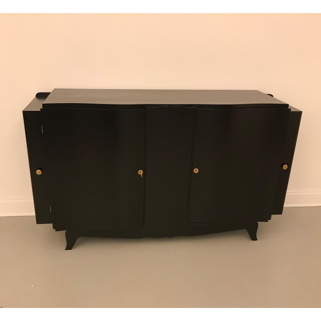 Stunning French Art Deco black lacquered sideboard or buffet with dry bar. Two hidden secret cabinets on the end of the...