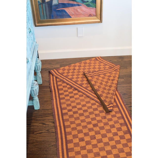 This is a beautifully handwoven Swedish rug in a delightful checkered pattern and a unique color palette. The beauty of...