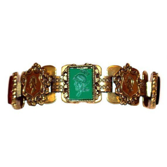 c1950's mid-century goldtone metal link bracelet set with Roman soldier intaglio glass stones and embellished with...