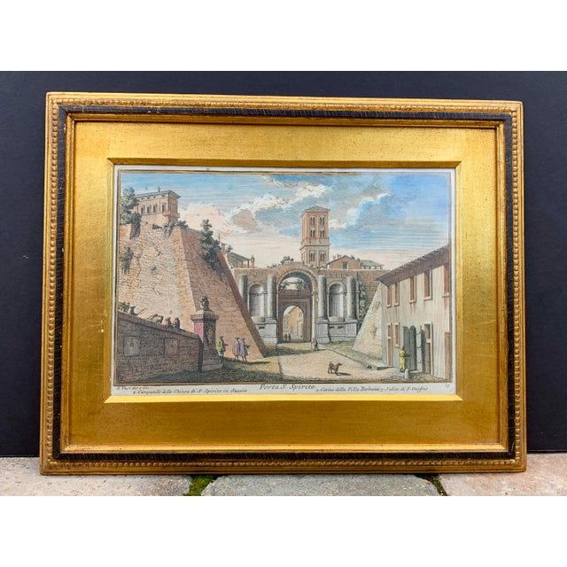 Vintage hand-colored engraving (plate No.15, the original etching dated 1747) by Giuseppe Vasi depicts a large gate in...