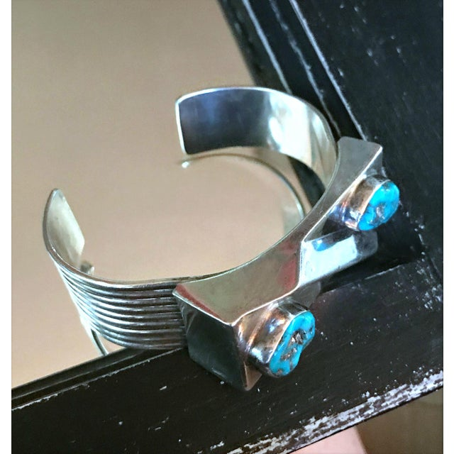 Beautiful silver bracelet from Scott Dave...The sides of the cuff have a freeway design...the top of the bracelet is...