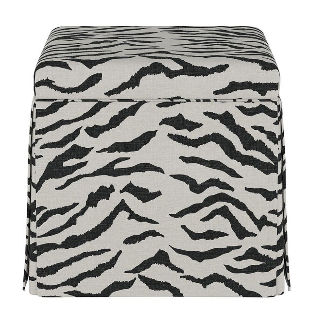 The sleek, fully upholstered design of this ottoman provides a perfect accent piece for any living room environment....