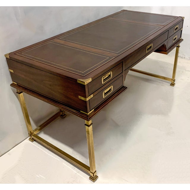 This is a 1970s Sligh campaign style mahogany, brass and leather desk. It has 5 drawers,and it is marked.