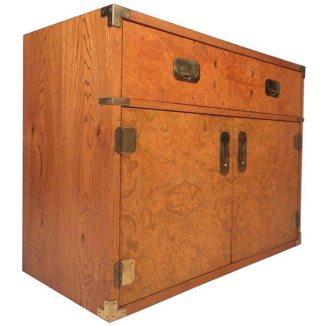 This stunning vintage modern Campaign chest features one large drawer and two cabinets that open to unveil a large...