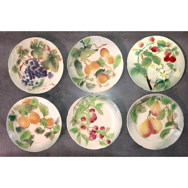 Set of six French faience majolic fruit plast from Keller & Guerin - St. Clement. Circa 1900-1920. Each plate measures...