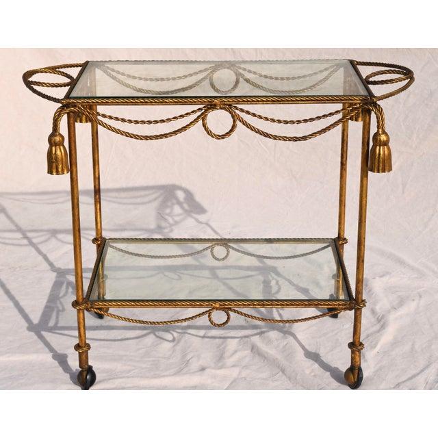 Hollywood Regency, Midcentury Italian gilt-metal bar cart with rope-and-tassel design as seen in designs of Hermes...