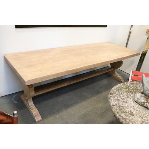 Beautiful early 20th century Spanish trestle base dining table made of bleached elm. Has wonderful mortise and tenon...