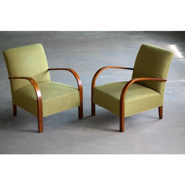 Superb pair of Danish late Art Deco early midcentury chairs from the early 1940s with spring cushions and solid beech wood...