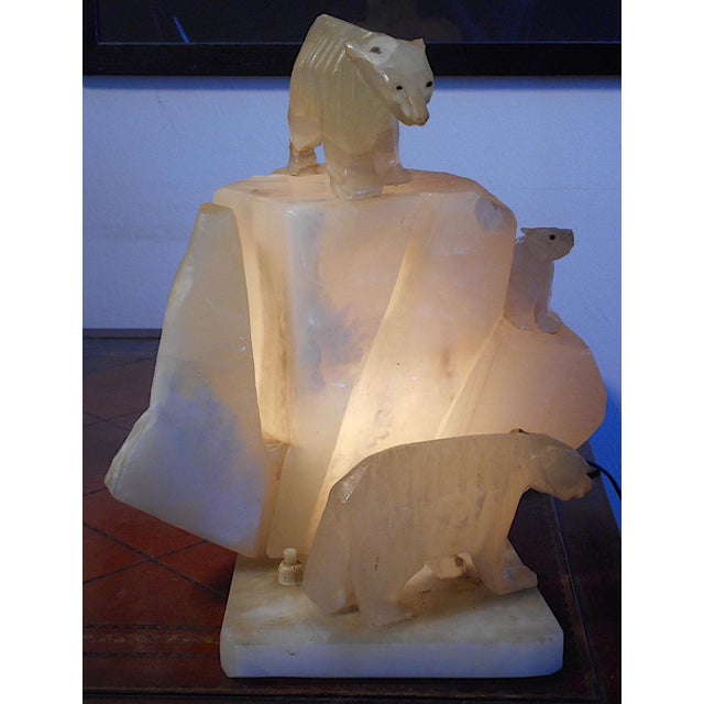 This rare carved polar bear/iceberg sculpture table lamp dates to the second or third quarter of the 20th century. it...