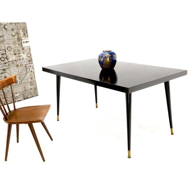 """Mid-Century Modern simple design very fine craftsmanship quality black laminate dining table with 1 12"""" extension board...."""