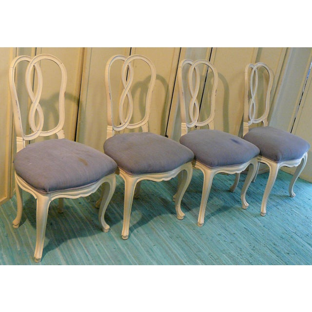 Incredible set of 4 pretzel-back dining chairs, made in Italy, dating to the early 20th century. These chairs were last...