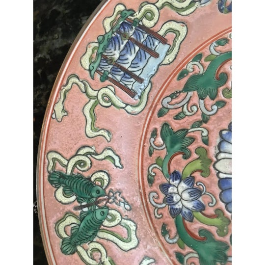 Stunning vintage pink porcelain Chinoiserie plate. The plate is decorated in the Chinese manner with the Eight Buddhist...