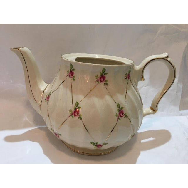 A beautiful English fine porcelain teapot by Sadler. Wonderful roses with gold highlights. Lid is gone.