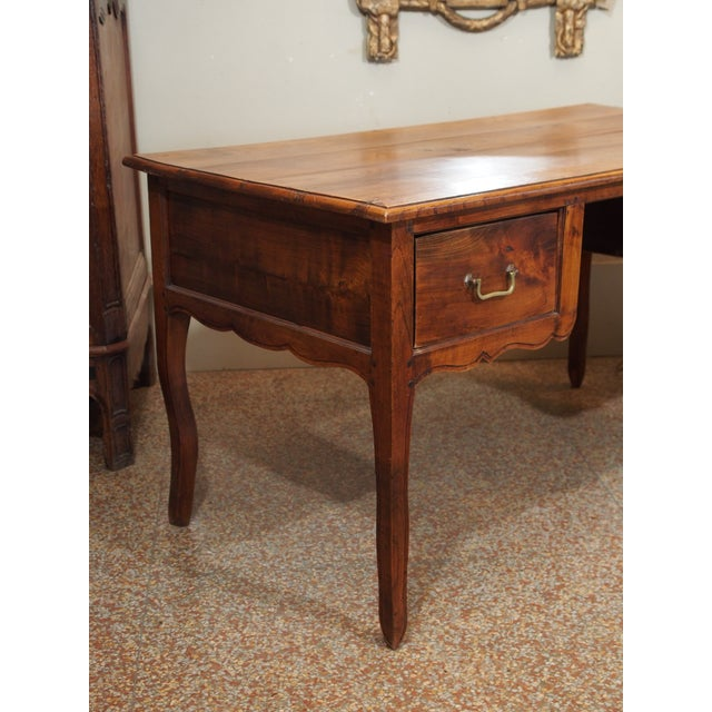 Beautiful rectangular desk with two deep drawers and cabriole legs. The top is made of pine and the bottom out of oak....