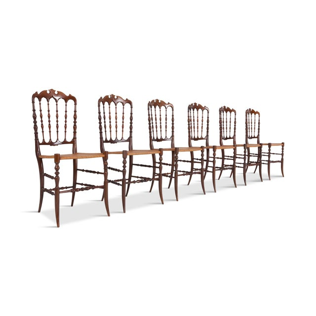 Cherrywood lightweight dining chairs, set of six. Provided with a beautiful crest rail, spindled back and woven wicker...