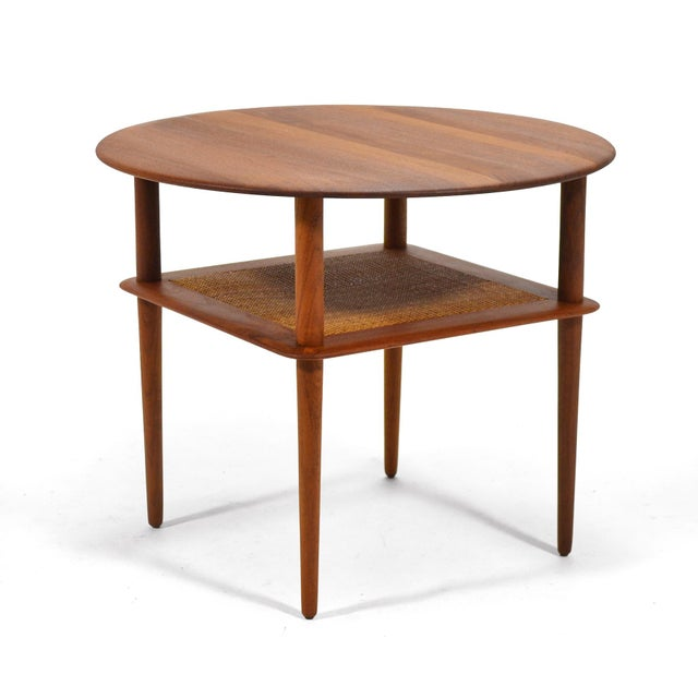 This rare Peter Hvidt & Orla Mølgaard-Nielsen design from 1956 is an uncommon round version of the two-tiered tables...