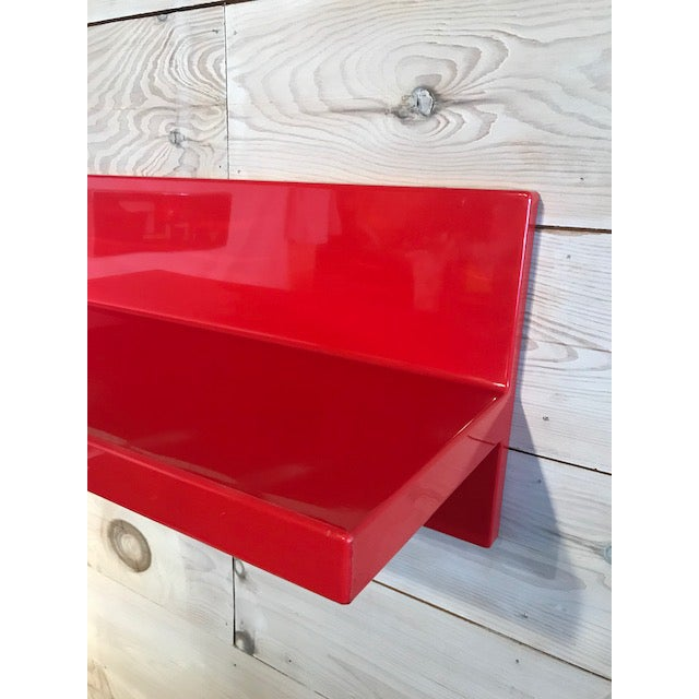 A rare red wall shelf designed by Marcello Siard for Kartell.