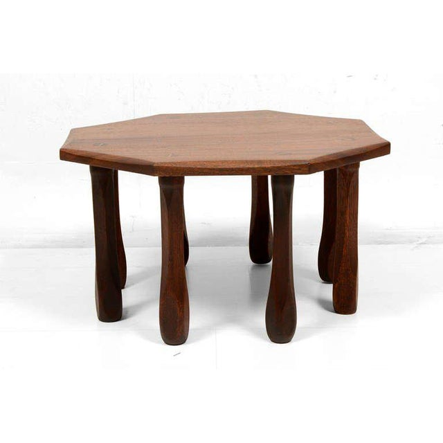 An antique custom-made side table in solid mahogany wood.
