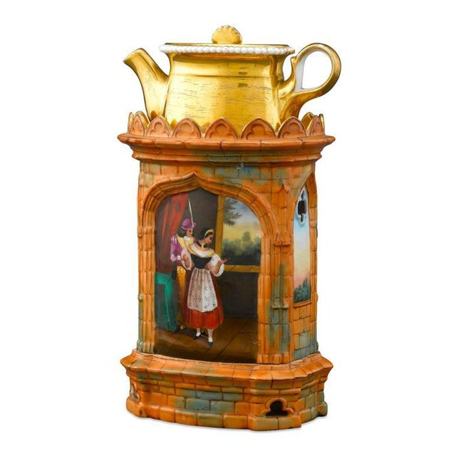 This excellent porcelain veilleuse is crafted in the form of an orange brick Gothic church, with hand-painted scenes, and...